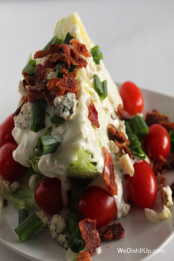 Wedge salad on white plate.