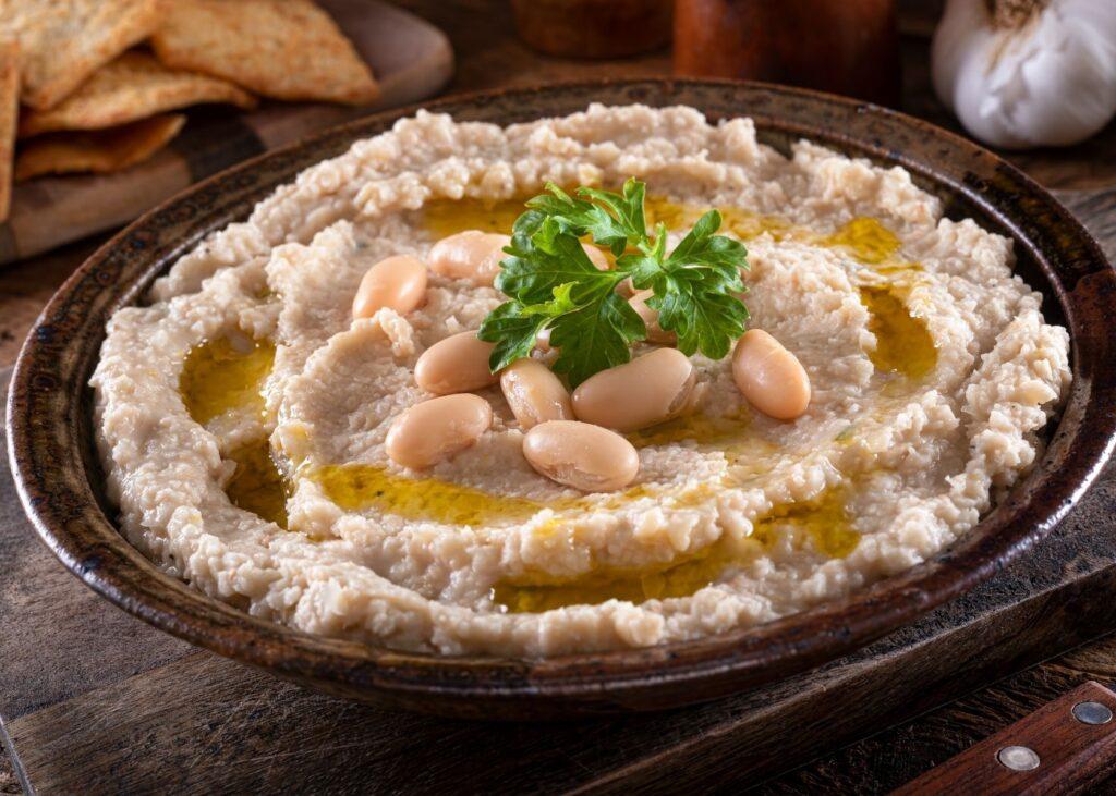 White bean dip in serving dish.