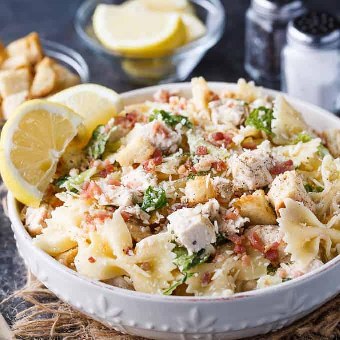 Chicken Caesar pasta salad in white bowl.