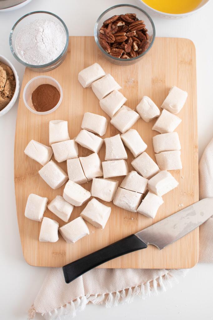 Cut scone dough on cutting board.