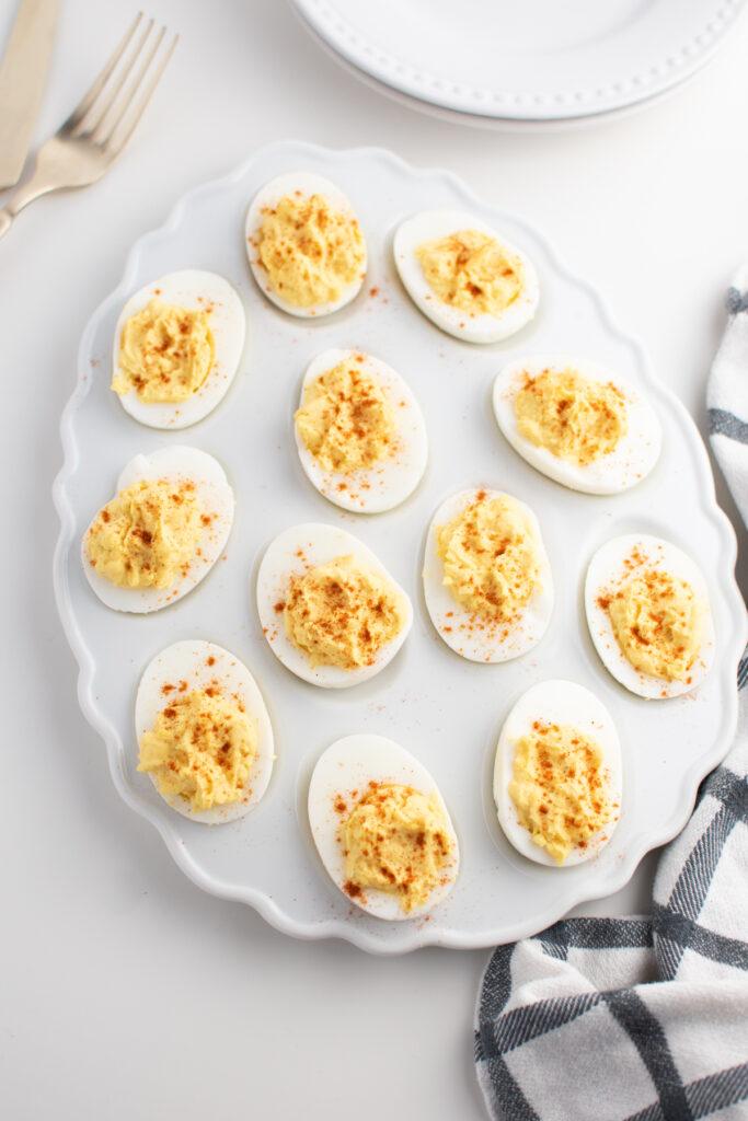 Easy deviled eggs on white platter.