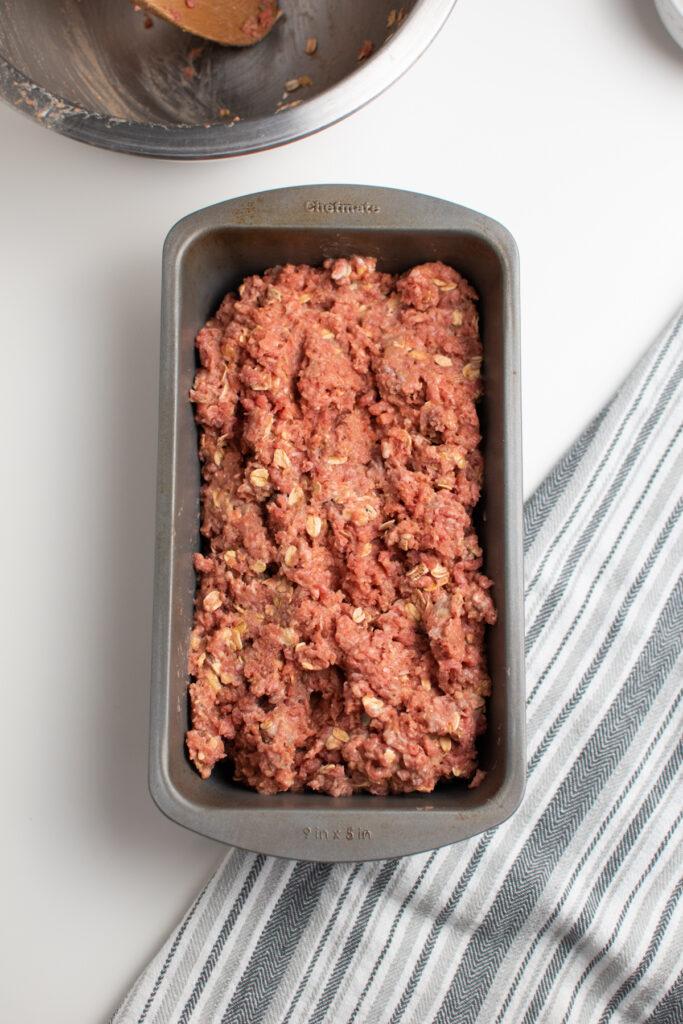 Meatloaf mixture in loaf pan.