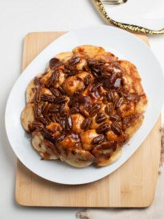 Overnight sticky buns on white platter.