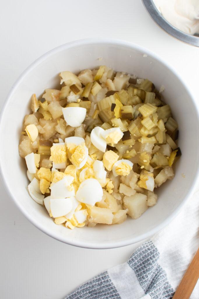 Potato salad ingredients in mixing bowl.