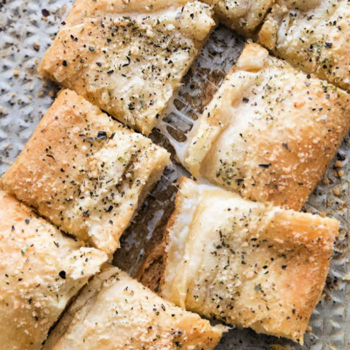 Pieces of stuffed cheesy bread.