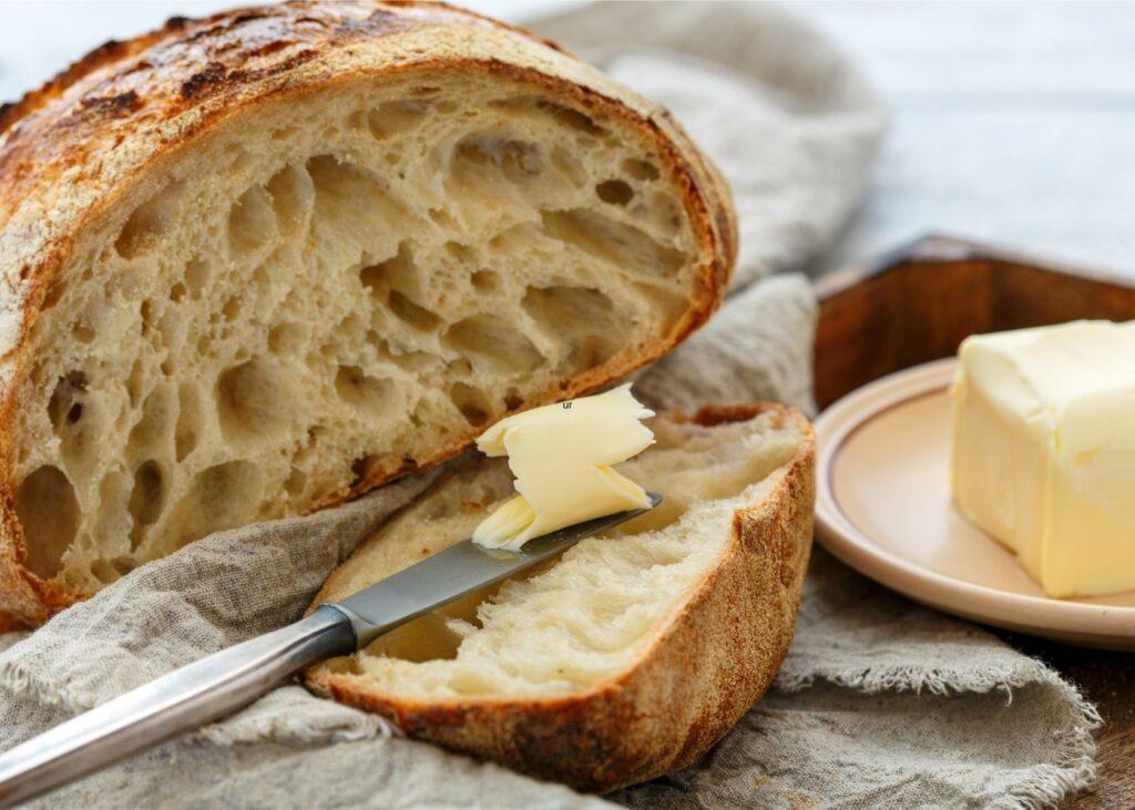 Butter is spread on bread.