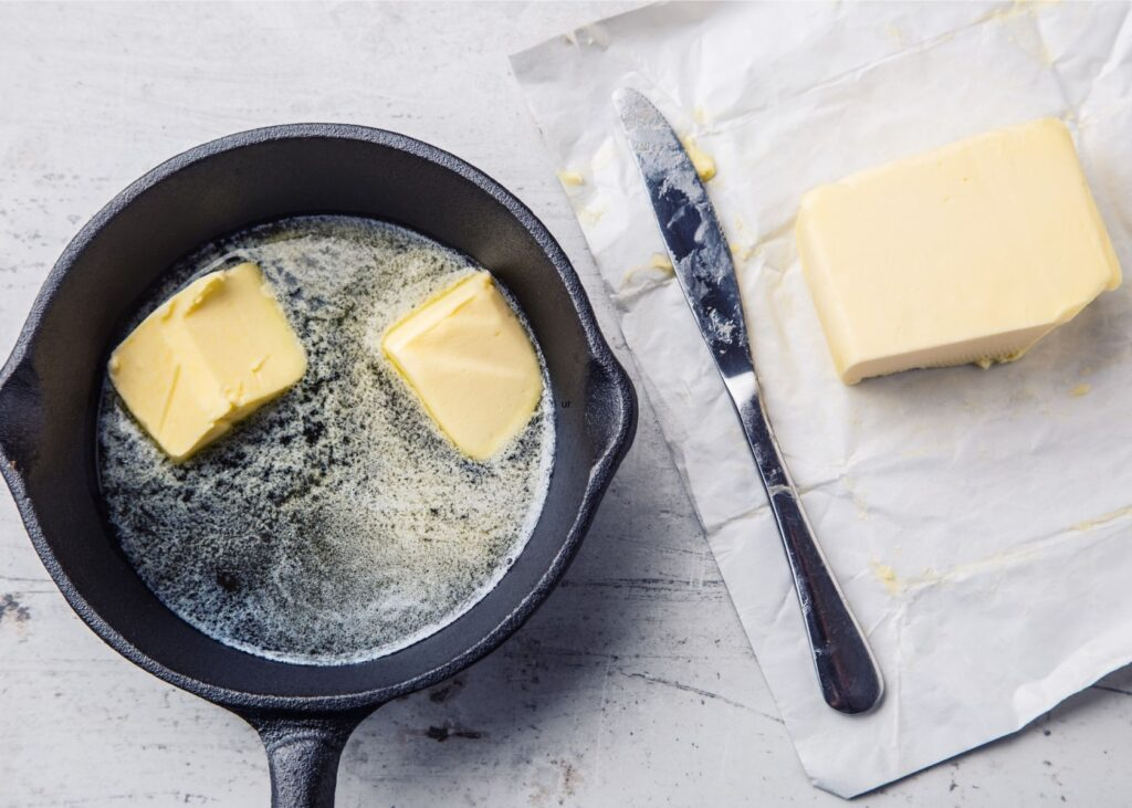 Melted butter in cast iron skillet.