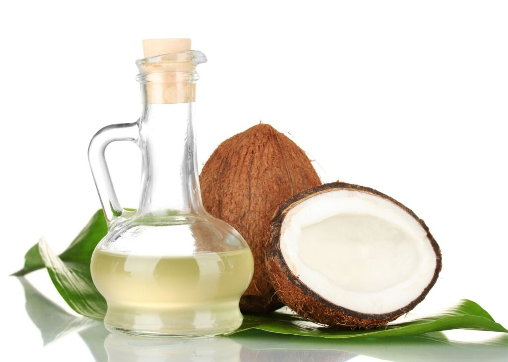 Coconut oil next to coconut shells.