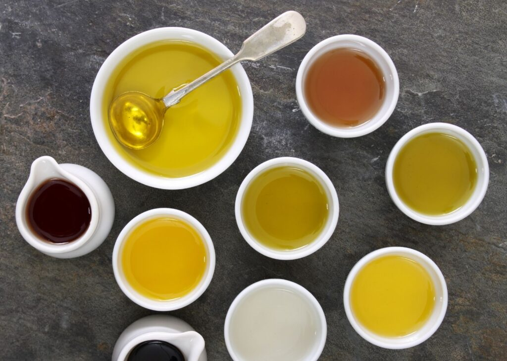Various oils in white bowls.