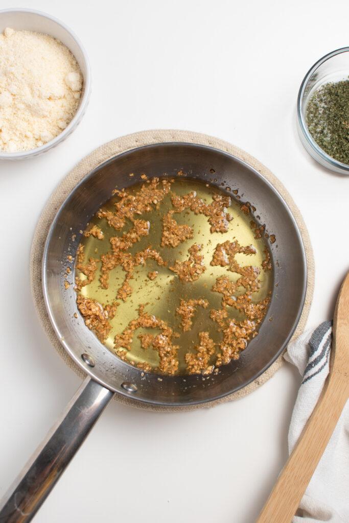 Browned garlic in small saute pan.