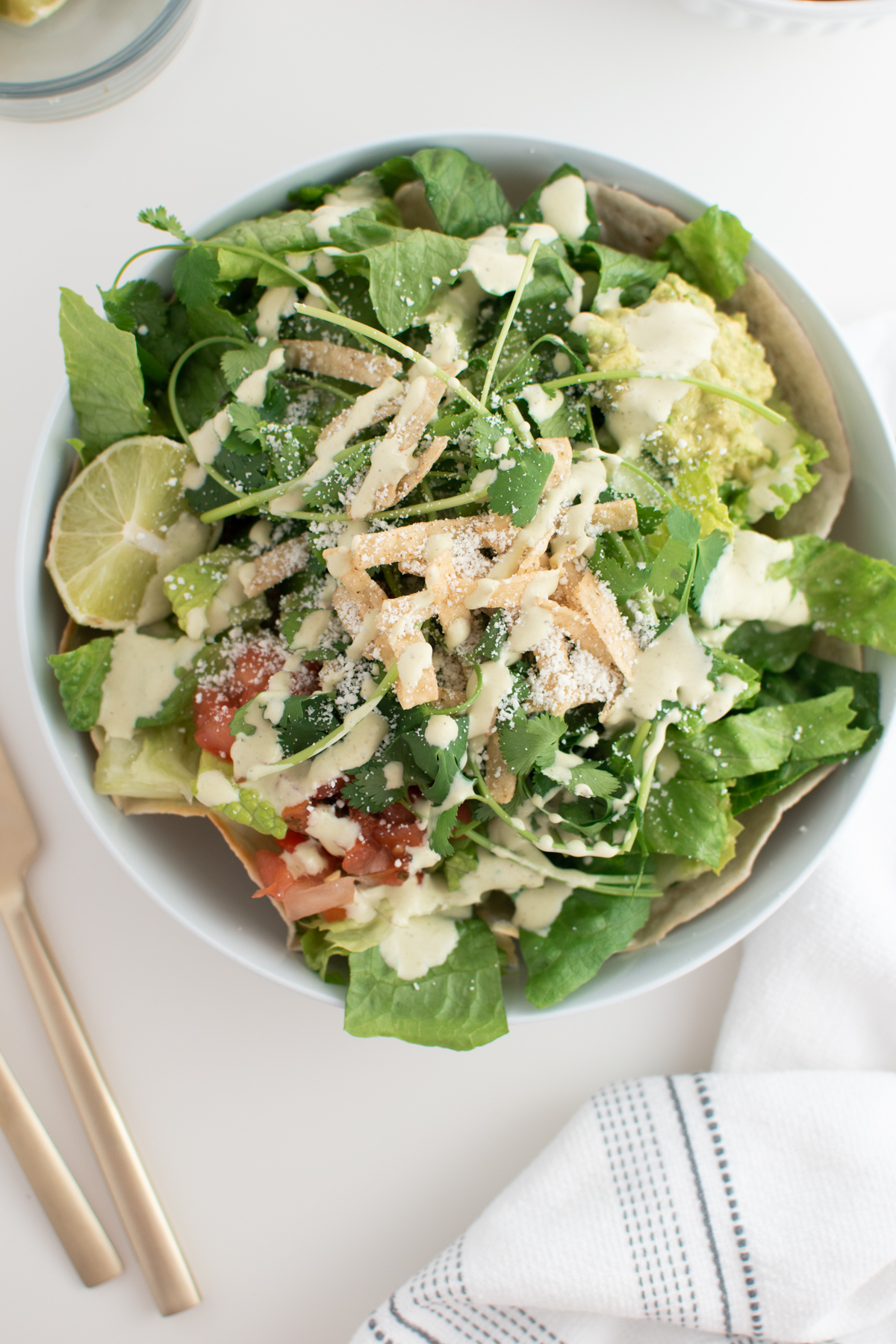 Cafe Rio salad dressing on chicken salad with lettuce, tortilla strips, pico, and guacamole.
