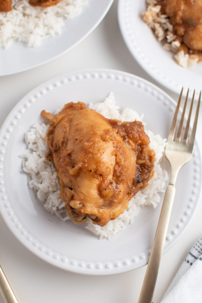 Crock Pot BBQ pineapple chicken on plate of rice.