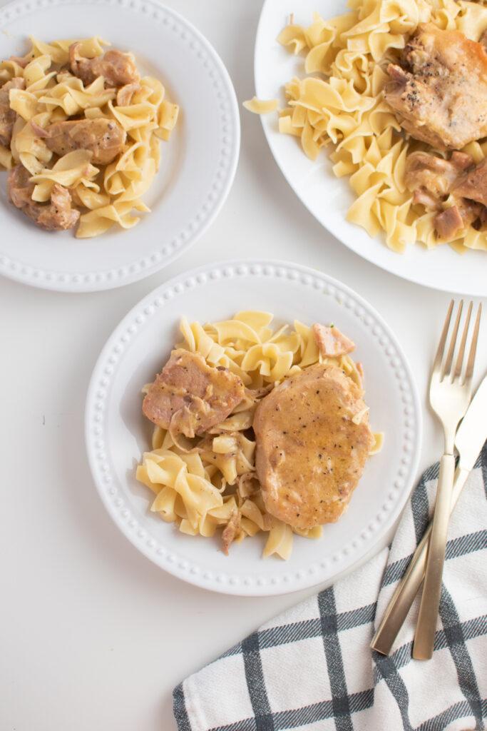 Slow cooker pork chops and gravy over egg noodles.