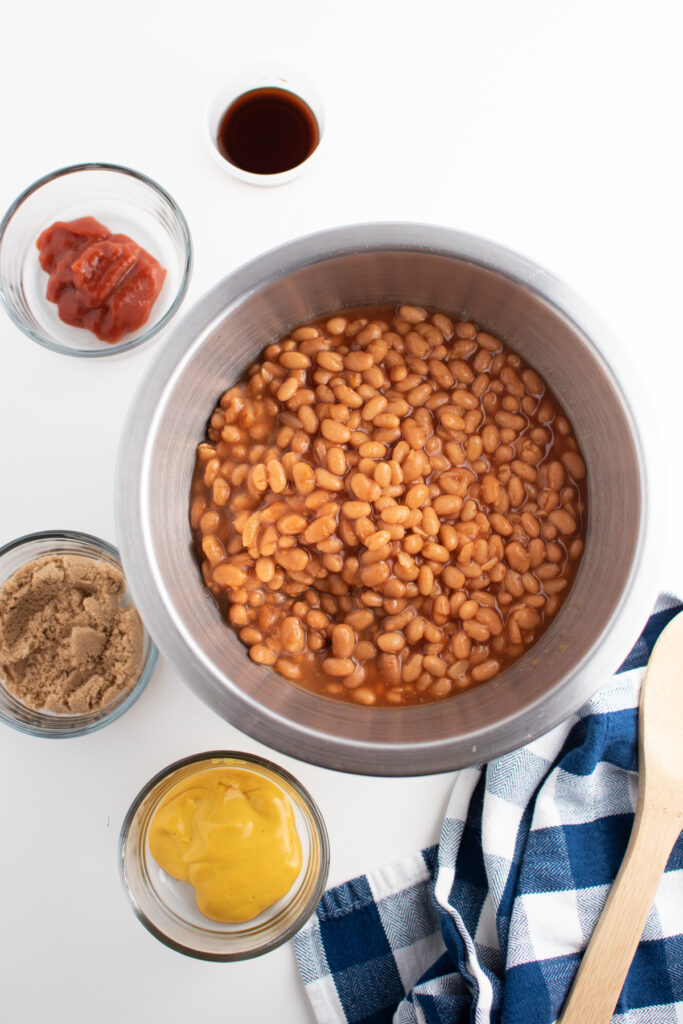 Baked beans ingredients on white table.