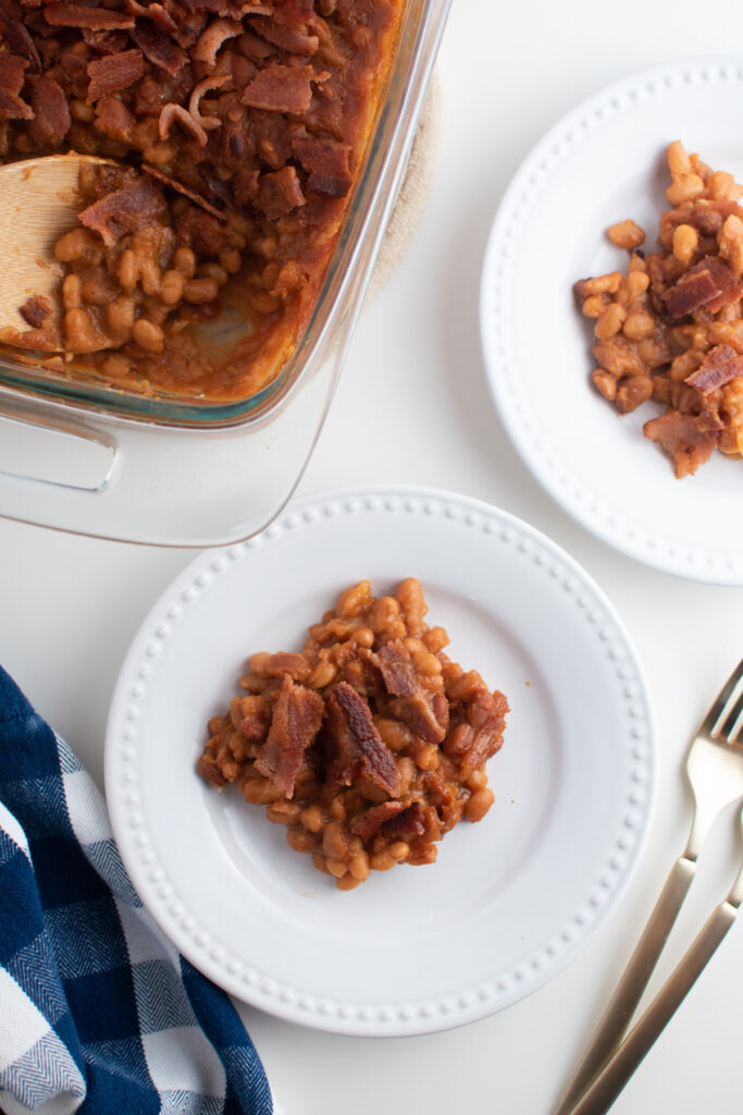 Baked beans with brown sugar on white plates.