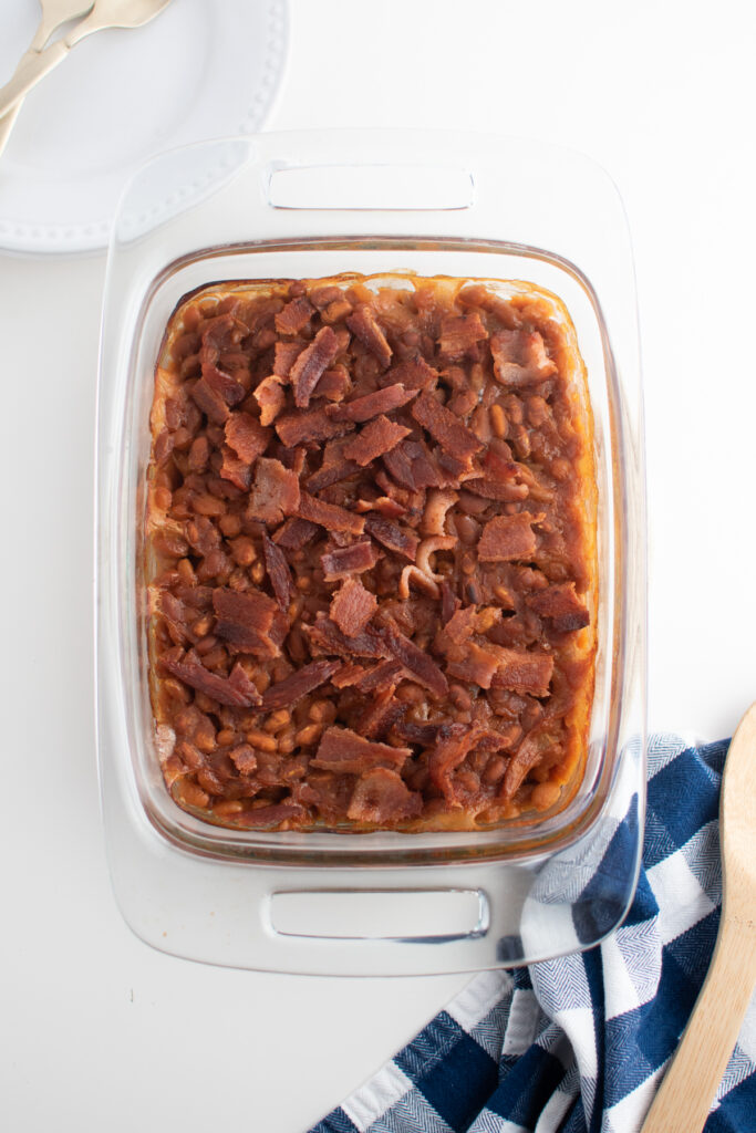 Baked beans with pork and beans in baking dish.