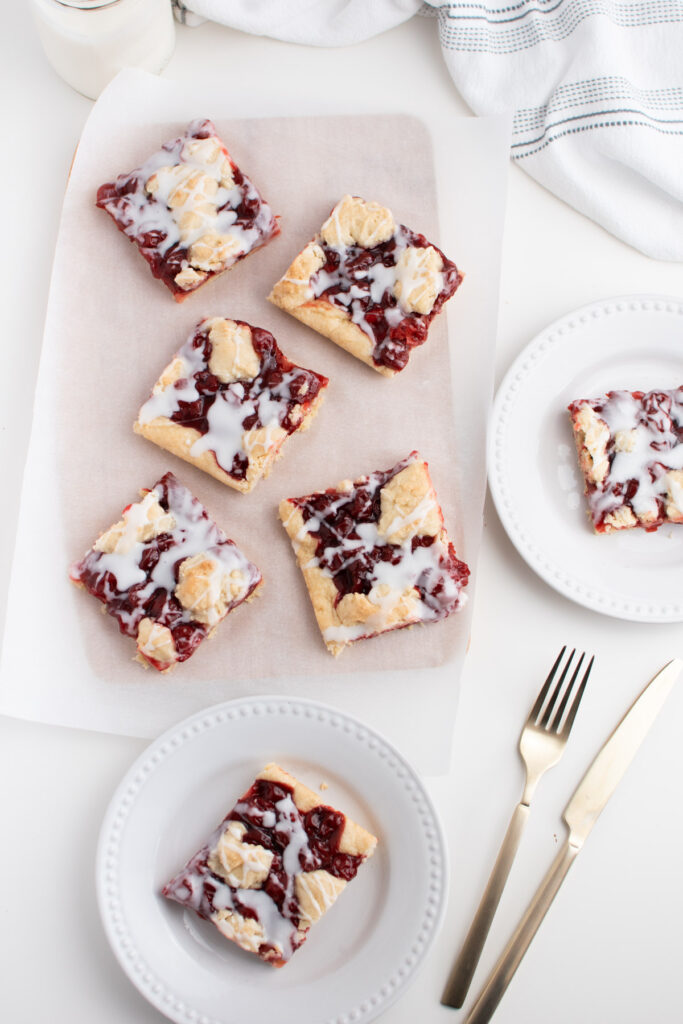 Cherry bars on white table.