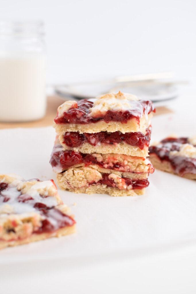 Stack of cherry pie bars.