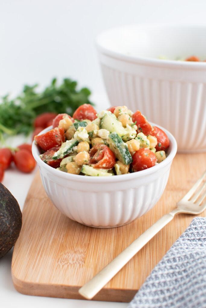 Cilantro chickpea salad in small white bowl.