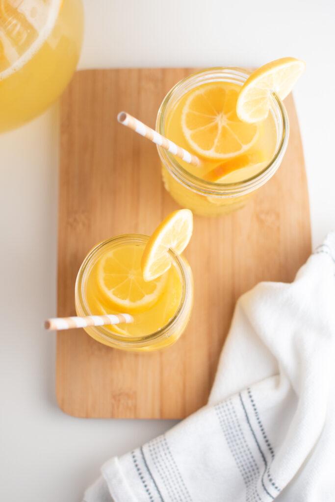 Lemonade with Meyer lemons in glass cups.