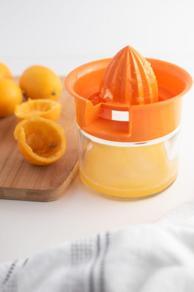 Meyer lemon juice in juicer.