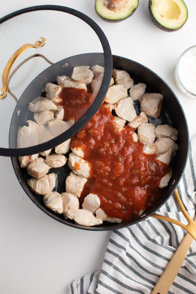 Picante sauce over chicken pieces.