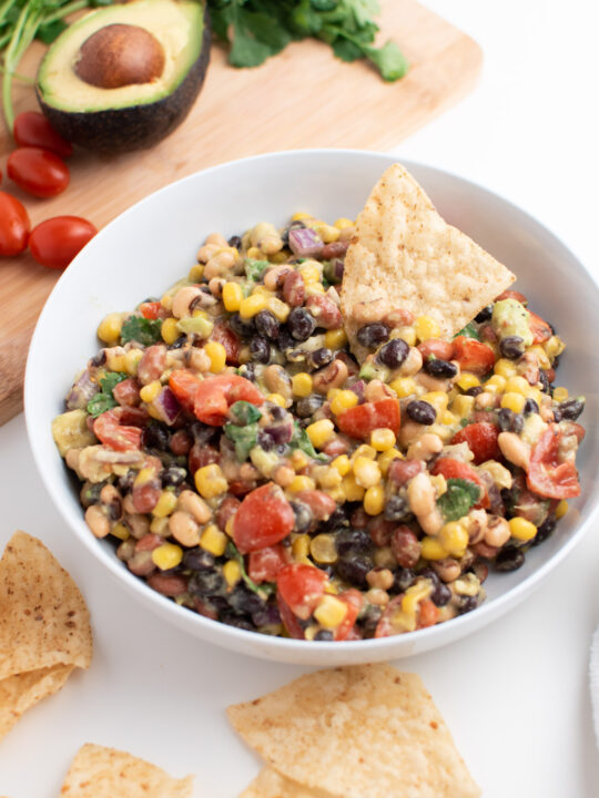 Bowl of cowboy caviar with tortilla chips.