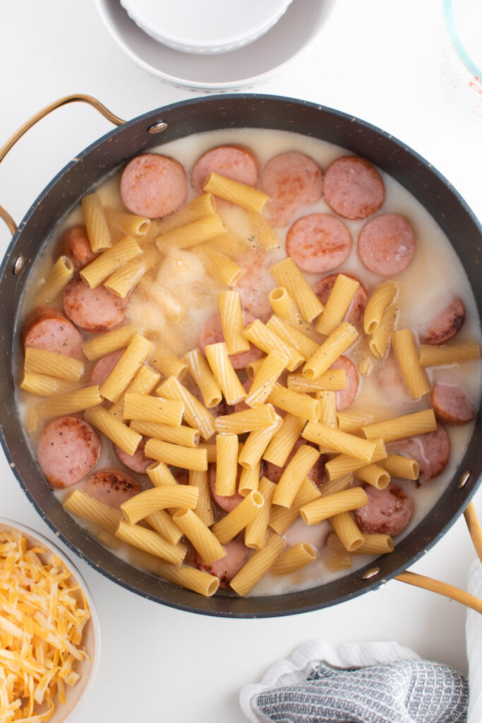 Rigatoni noodles in broth.