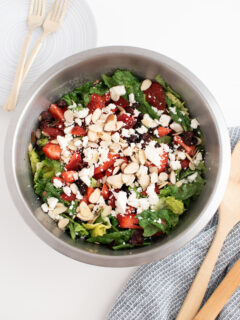 Large bowl of spinach strawberry salad.