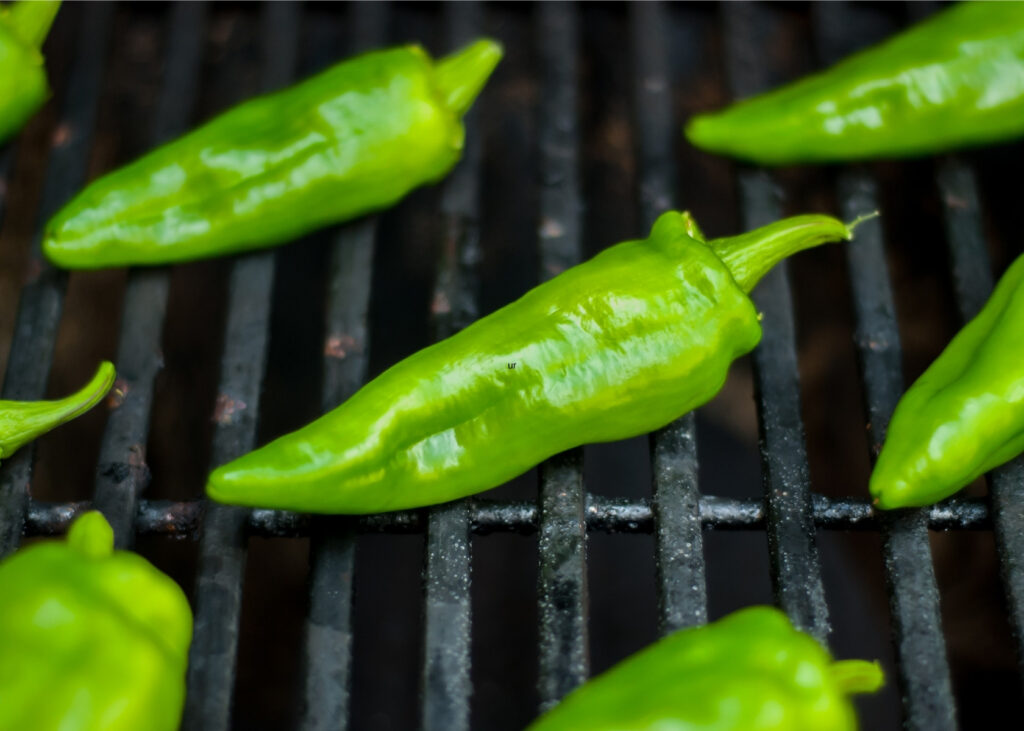 Anaheim peppers on grill grate.