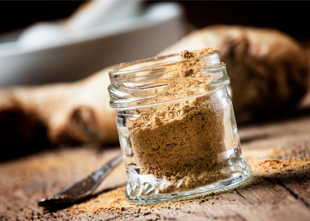 Ground ginger in glass jar.