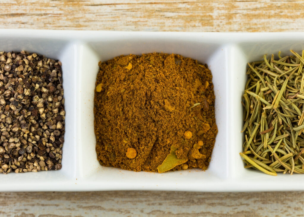 Spice blend in white dish.