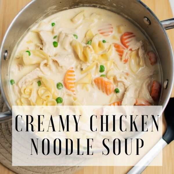 Graphic with pot of creamy chicken noodle soup and text overlay.